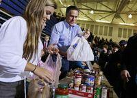 Romney_handing_out_food-bag