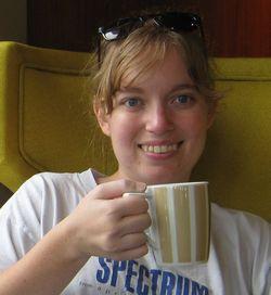 Robin with coffee on cruise